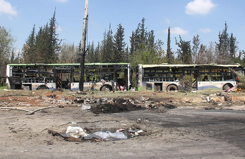 A picture taken on April 16, 2017, shows the damage a day after a suicide car bombing attack in Rashidin, west of Aleppo, targeted busses carrying Syrians evacuated from two besieged government-held towns of Fuaa and Kafraya (AFP Photo)