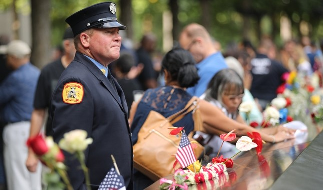 Friends and family of victims of the terrorist attacks, pause at the National September 11 Memorial during a morning commemoration ceremony for the victims of the terrorist attacks 18 years after the day on Sept. 11, 2019 in NYC. AFP Photo