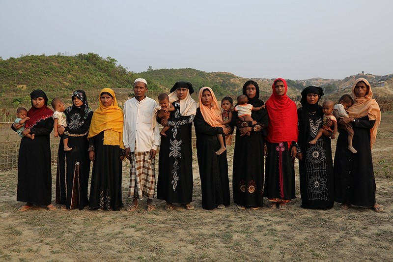 Relatives of ten Rohingya men killed by Myanmar security forces and Buddhist villagers Sept. 2, 2017, pose for a group photo in Cox's Bazar, Bangladesh, March 23, 2018. (Reuters Photo)