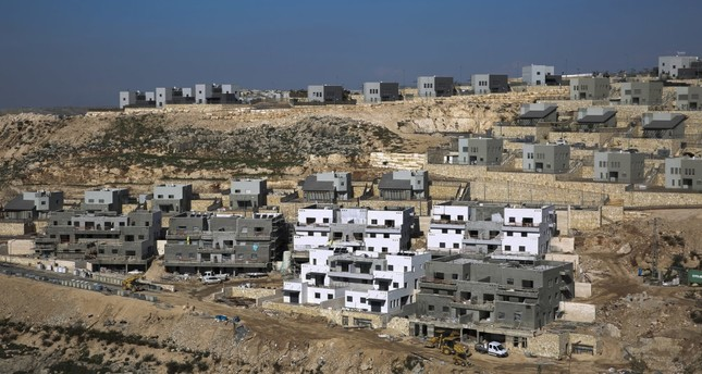 Israel expands illegal Jewish settlements in the occupied West Bank through new housing projects, Jan. 1, 2019.