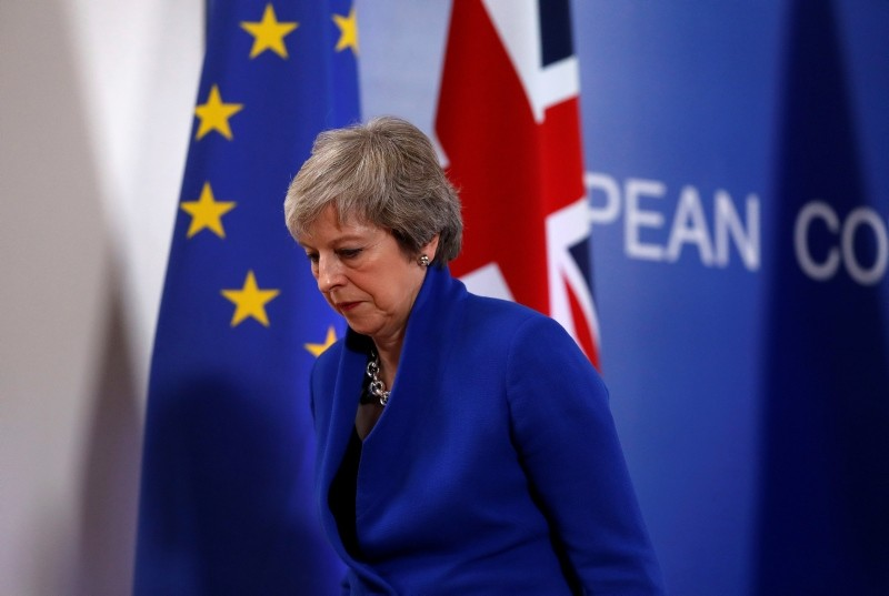 British Prime Minister Theresa May leaves the stand after a media conference in Brussels, Sunday, Nov. 25, 2018. (AP Photo)