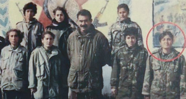 Terrorist Ayfer Kordu pictured with jailed PKK leader Abdullah Öcalan and other terrorists in this undated photo (AA Photo)