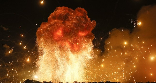 A powerful explosion is seen in the ammunition depot at a military base in Kalynivka, west of Kiev, Ukraine, early Wednesday, Sept. 27, 2017. (AP Photo)
