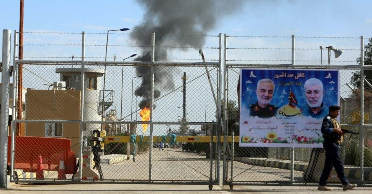 A poster of Iraqi militia commander Abu Mahdi al-Muhandis and Iranian military commander Qassem Soleimani hangs on the door of West Qurna-1 oil field, which is operated by ExxonMobil, Basra, Iraq, Jan. 9, 2020. (Reuters Photo)