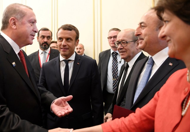 President Erdoğan (L) shakes hands with French Def. Min. Goulard (R) as he & FM Çavuşoğlu (2nd R) meet with their French counterparts, Pres. Macron (2nd L) & Minister for Europe & Foreign Affairs,  Le Drian, (3rd R) ahead of NATO summit in Brussels.