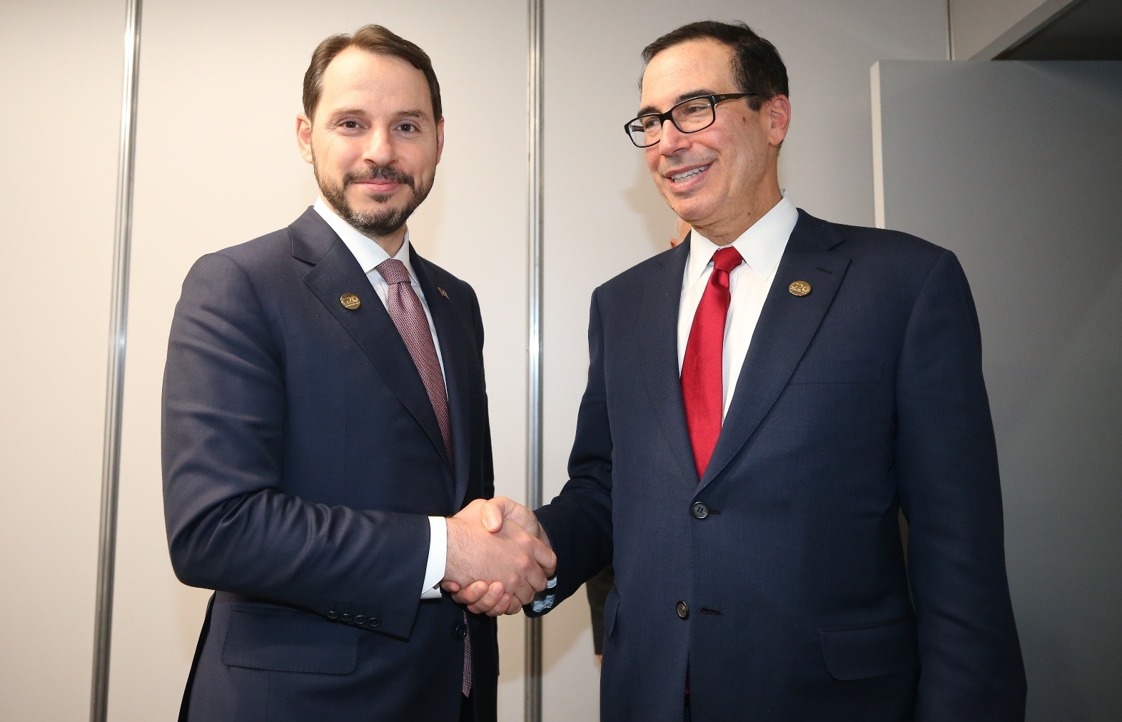 Treasury and Finance Minister Berat Albayrak (L) meets with U.S. Secretary of Treasury Steven Munchin on the sidelines of the G20 Meeting of Finance Ministers in Buenos Aires, Argentina, July 21, 2018.