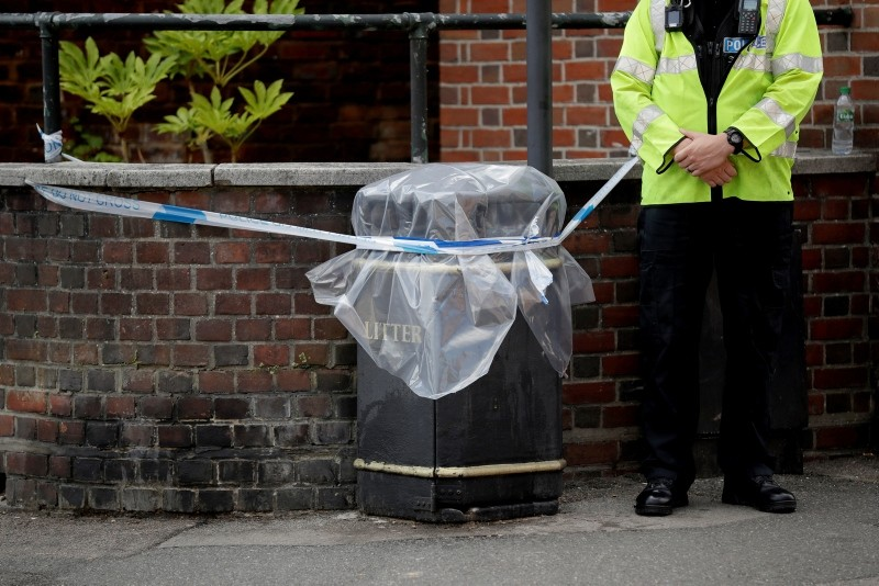 In this file photo dated Thursday, July 5, 2018, an unidentified British police officer guards a cordon in Salisbury, England. (AP Photo)