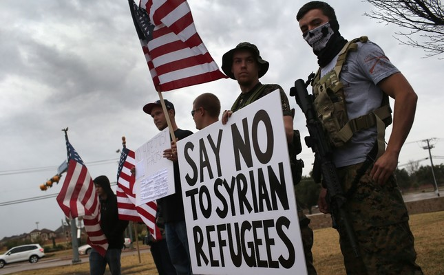 Armed protesters of a far-right U.S. group during a demonstration against Muslim refugees in front of a mosque in Richardson, Texas, Dec. 12, 2015.