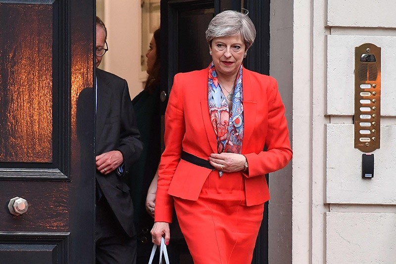 British Prime Minister Theresa May leaves the Conservative Party HQ in central London, on June 9, 2017, hours after the polls closed in the British general election. (AFP Photo)
