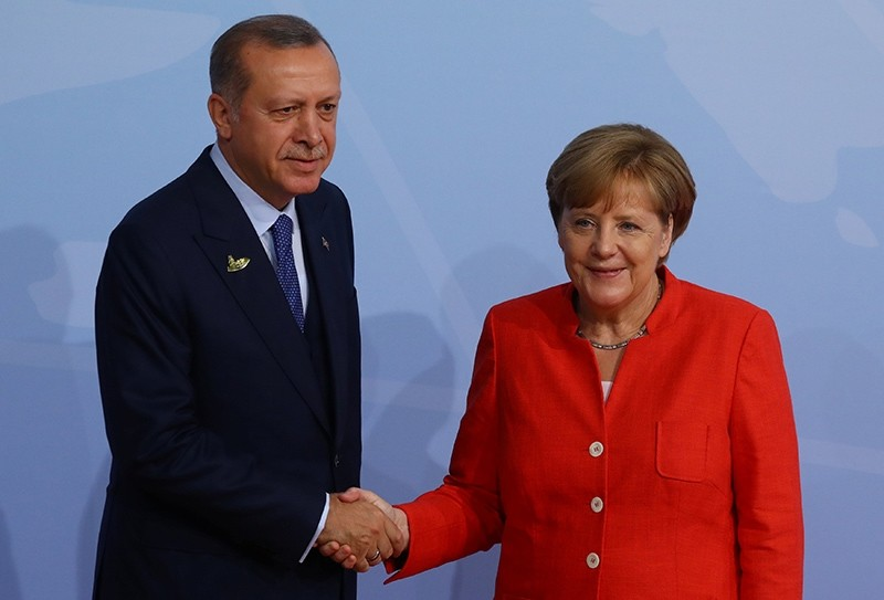 President Recep Tayyip Erdou011fan shakes hands with German Chancellor Angela Merkel as he arrives for the G20 leaders summit in Hamburg, Germany, July 7, 2017. (Reuters Photo)