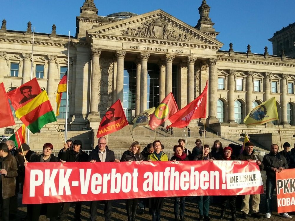 Pro-PKK supporters seen holding a banner that reads ,Lift the PKK ban, during a demonstration in front of the Reichstag building in Berlin to show solidarity with the terrorist group