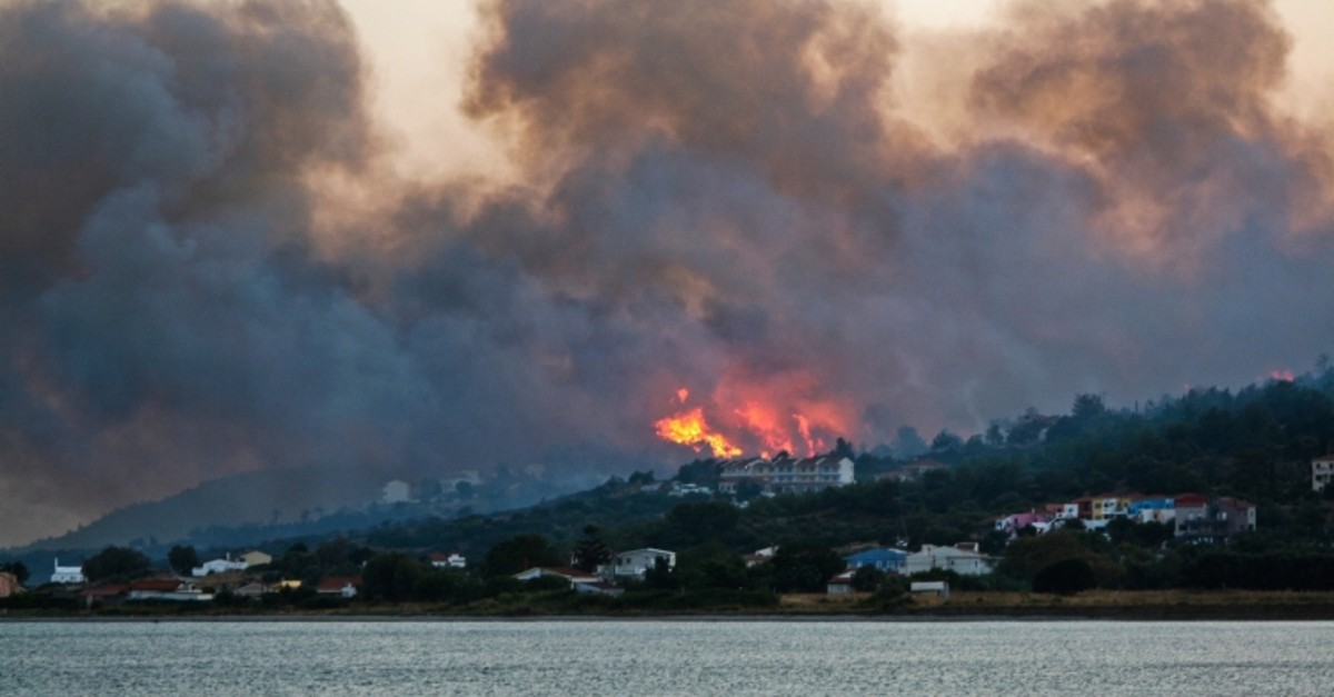 In this Saturday, Aug. 24, 2019 photo shows a wildfire burns a forrest near Pythagorio town on the eastern Greek island of Samos. (AP Photo)
