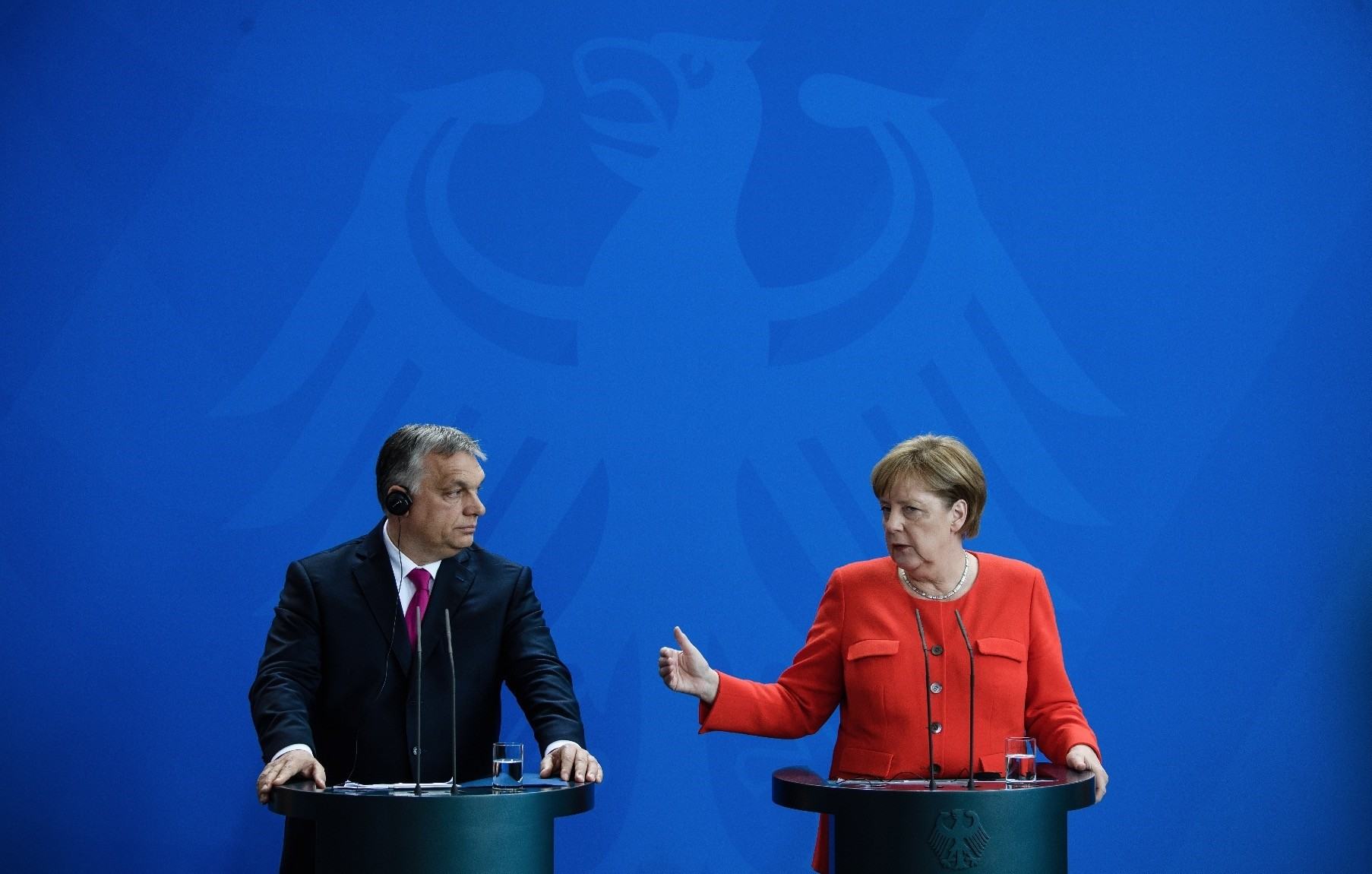 Prime Minister of Hungary Viktor Orban (L) and German Chancellor Angela Merkel (R) address a joint press conference at the Chancellery, Berlin, July 5.