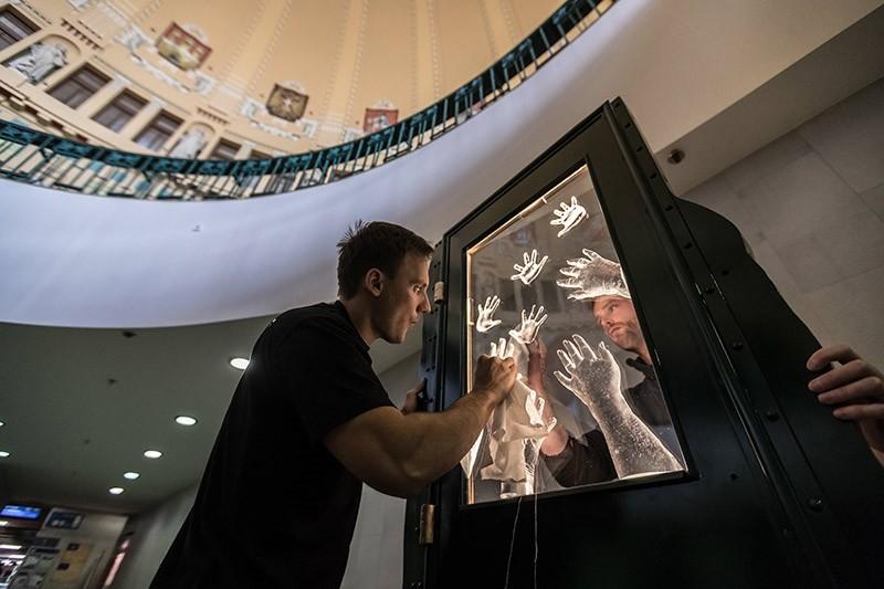 Jan Hunat, Czech glassmaker installs the 'Farewell Memorial' at Main Railway Station in Prague, Czech Republic, 23 May 2017. (EPA Photo)
