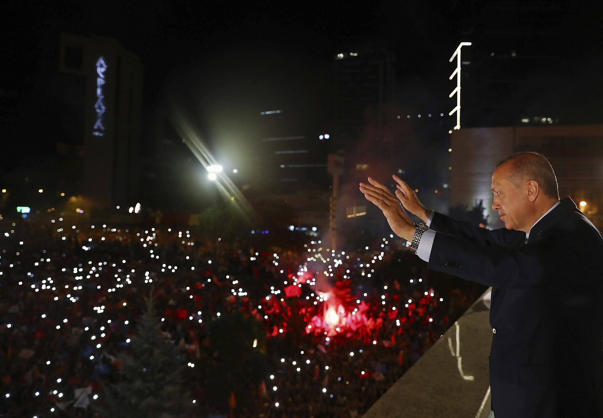 President Erdou011fan waves to supporters celebrating his and the AK Party's victory in Sunday's elections, Ankara, early Monday.