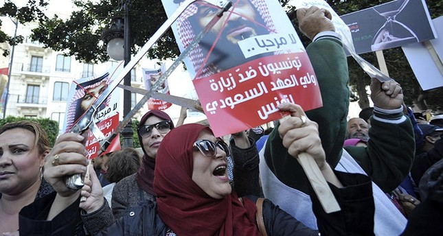 Tunisian protesters holding placards with inscription reading in Arabic 'Tunisians against Saudi Crown Prince visit' shout slogans during a protest in Tunis, Tunisia, Nov. 27, 2018. (EPA Photo)