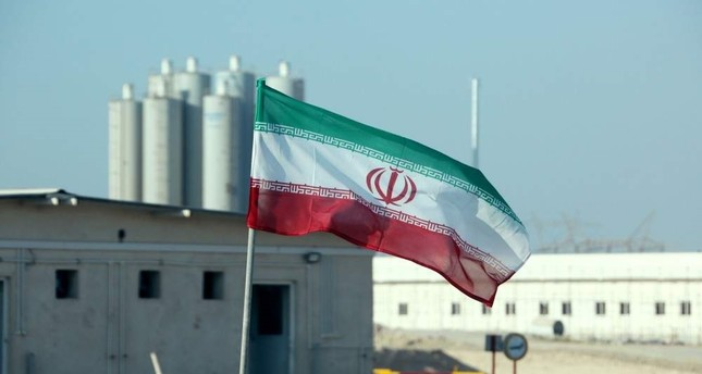 An Iranian flag flutters in Iran's Bushehr nuclear power plant, during an official ceremony to kick-start works on a second reactor at the facility, Nov. 10, 2019. AFP Photo