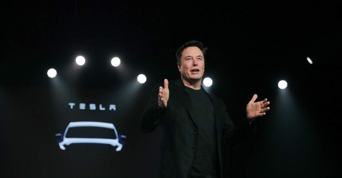 In this file photo, Tesla CEO Elon Musk speaks before unveiling the Model Y at Tesla's design studio in California,  March 14, 2019, (AP)