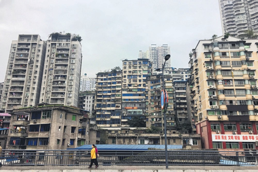 Residential buildings are seen in Zhongxian, Chongqing., whose government has a plan to reinvent its economy with a $211.6 million online gaming complex that it hopes will cash in on China's fast-growing e-sports market.