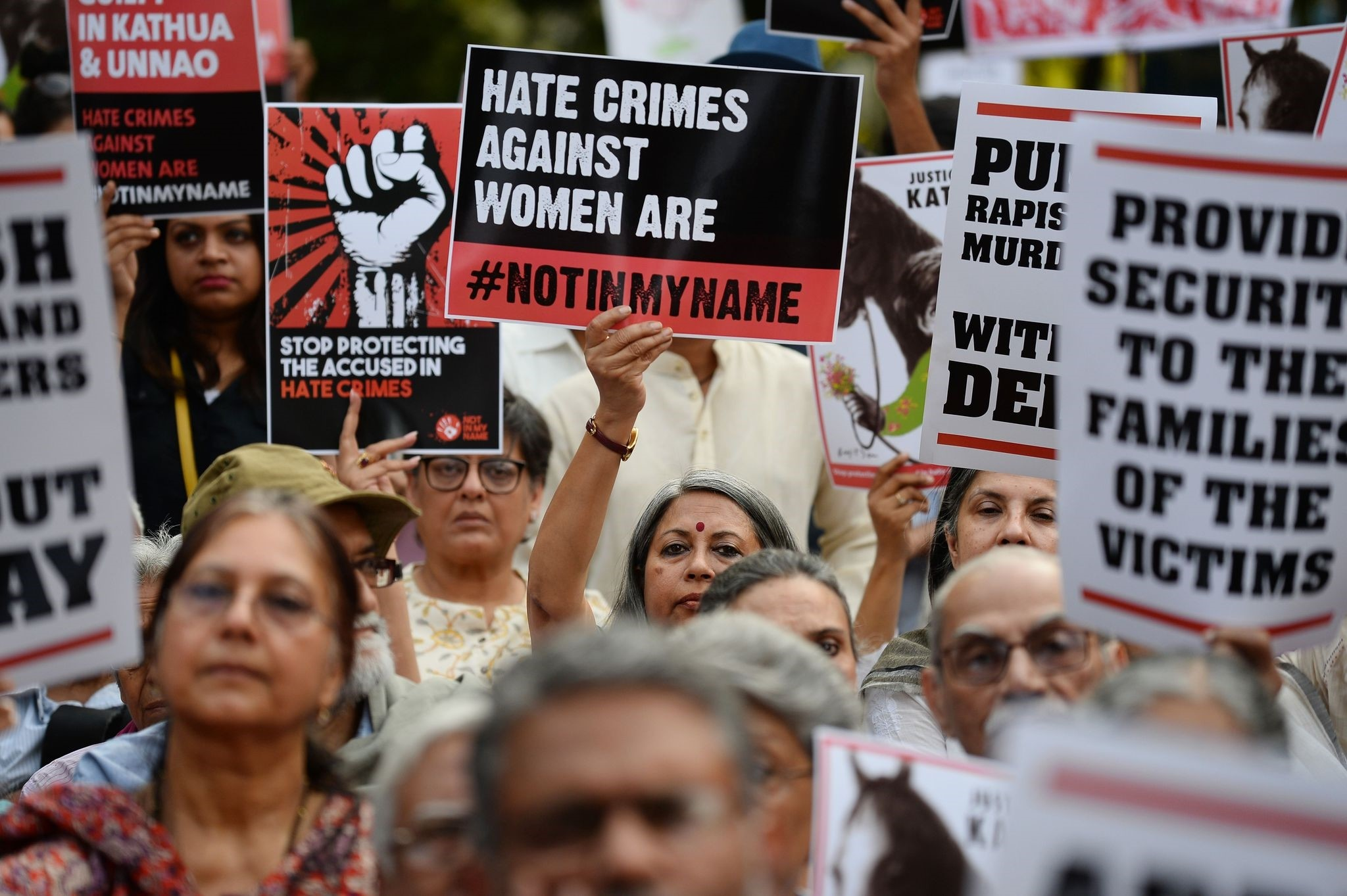 In this file photo taken on April 15, 2018 Indian demonstrators hold placards during a 'Not In My Name' protest in support of rape victims following high profile cases in Jammu and Kashmir and Uttar Pradesh states, in New Delhi. (AFP Photo)