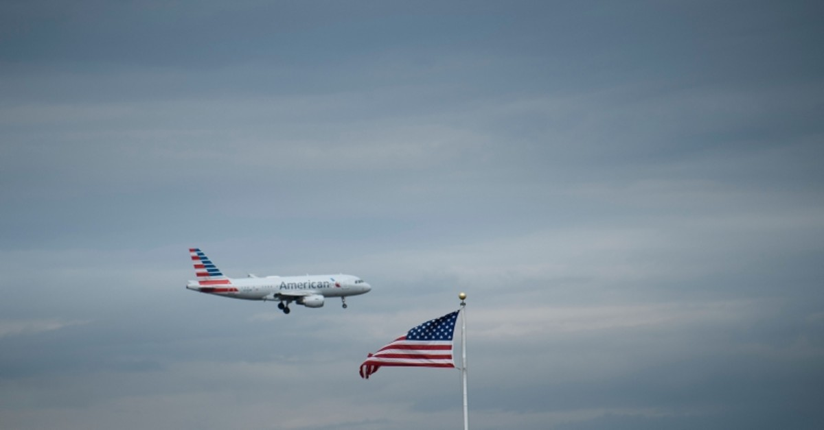 In this file photo taken on May 09, 2019, an American Airlines passenger jet approaches Ronald Reagan Washington National Airport, in Arlington, Virginia. (AFP Photo)