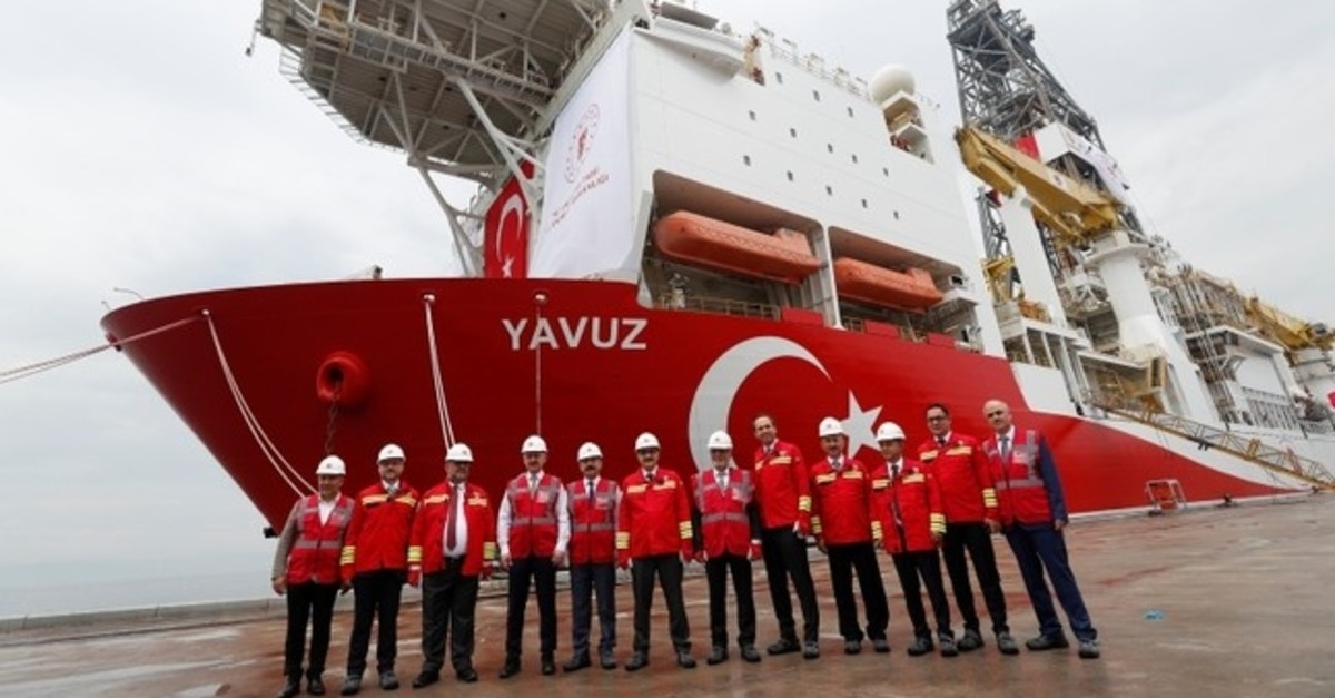 Turkey's Energy Minister Fatih Du00f6nmez and the other officials pose in front of the Turkish drilling vessel Yavuz at Dilovasu0131 port in the northwestern Kocaeli province, Turkey, June 20, 2019. (Reuters Photo)