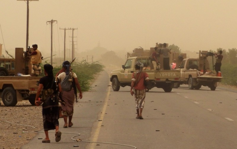 Yemeni pro-government forces gather at the south of Hodeida airport, in Yemen's Hodeida province. (AFP Photo)