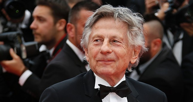 This file photo taken on May 17, 2014 shows French director Roman Polanski posing as he arrives for the screening of the film Saint-Laurent at the 67th edition of the Cannes Film Festival in Cannes, southern France. (AFP Photo)