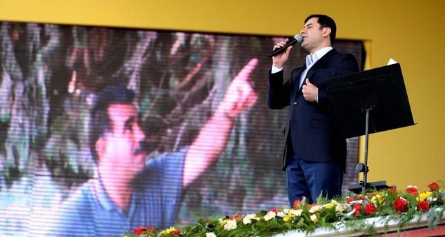 Demirtaş gives a speech in front of an image of PKK leader Öcalan