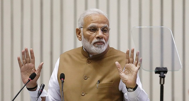 India's Prime Minister Narendra Modi gestures as he addresses the gathering during the 'Global Mobility Summit' in New Delhi, India, Sept. 7, 2018. (Reuters Photo)
