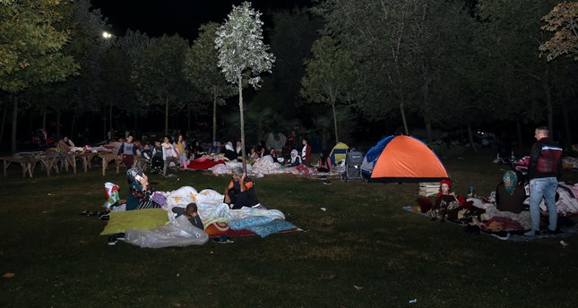People sleep in tents and outdoors after a 5.8 magnitude earthquake in Istanbul, Sept. 27, 2019.
