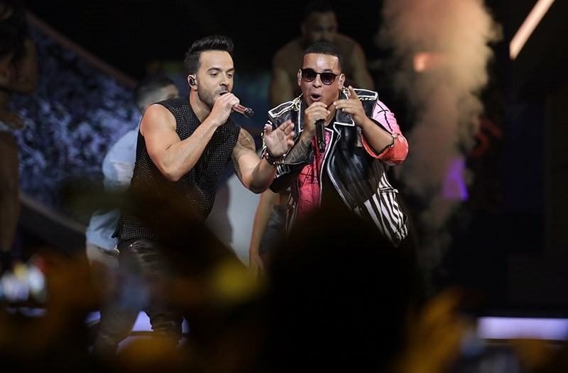 In this April 27, 2017 file photo, singers Luis Fonsi, left and Daddy Yankee perform during the Latin Billboard Awards in Coral Gables, Fla. (AP Photo)
