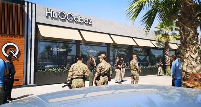 Security forces gather at the scene of a shooting outside a restaurant in Irbil, Iraq, Wednesday, July 17, 2019. AP Photo