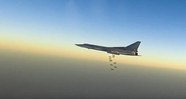 In this frame grab from video provided by the Russian Defence Ministry Press Service, Russian long range bomber Tu-22M3 flies during a strike above an undisclosed location in Syria (AP Photo)