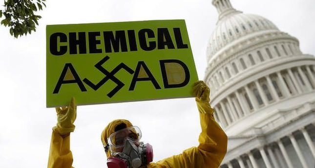 Syrian American protesters outside the US Capitol urging Congress to support President Obama in striking Syria for using chemical weapons against its own people. (AFP Photo)