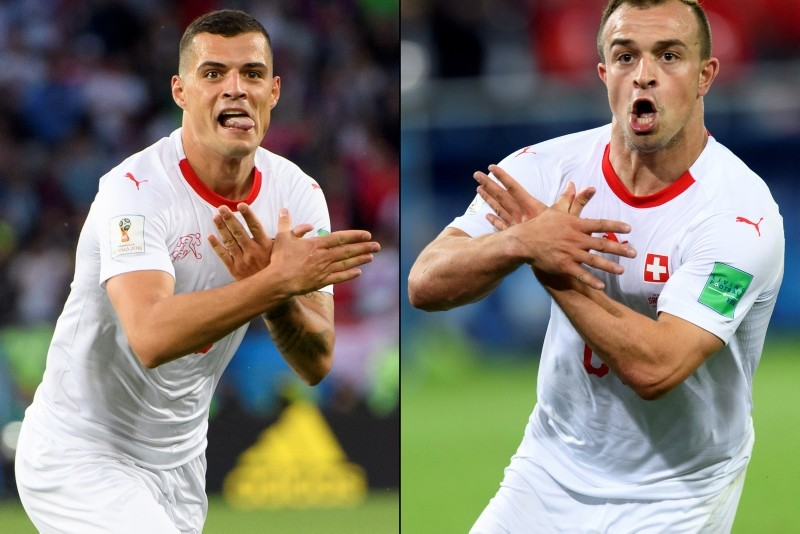 A combo picture shows Switzerland's Granit Xhaka, left, and Xherdan Shaqiri celebrate their World Cup 2018 goals against Serbia by forming an eagle with their hands at the Arena Baltika Stadium in Kaliningrad, Russia, June 22, 2018. (EPA Photo)