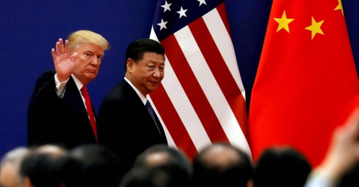 U.S. President Donald Trump and China's President Xi Jinping meet business leaders at the Great Hall of the People in Beijing, China, November 9, 2017 (Reuters File Photo)