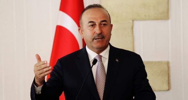 Foreign Minister Mevlüt Çavuşoğlu talks at a press conference during a visit in the Turkish Republic of Northern Cyprus, in the city of Lefkoşa, July 24, 2018. (REUTERS Photo)