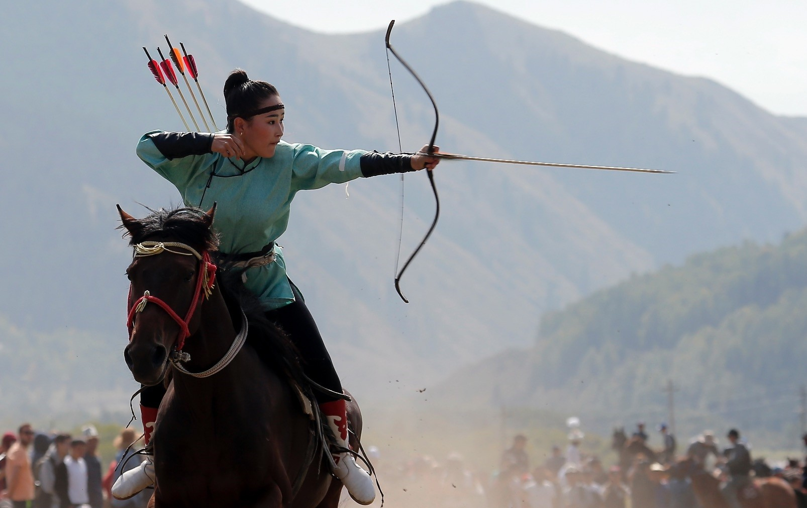 A woman takes part in an archery event during the 3rd World Nomad Games at Issyk-Kul lake.