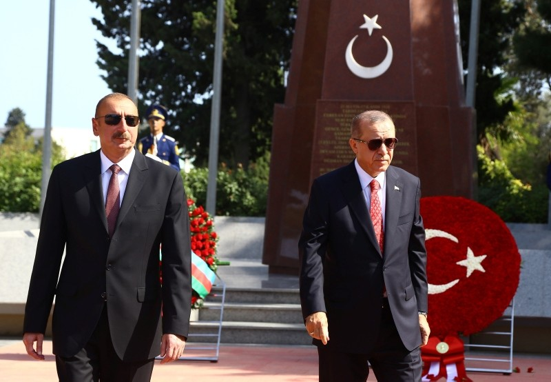 President Recep Tayyip Erdou011fan (R) and his Azerbaijani counterpart Ilham Aliyev visit the Turkish Cemetary in Baku, Azerbaijan, on Sept. 15, 2018. (AA Photo)