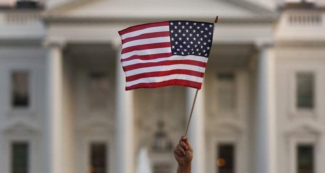 A flag is waved outside the White House, Washington, September 2017. AP Photo