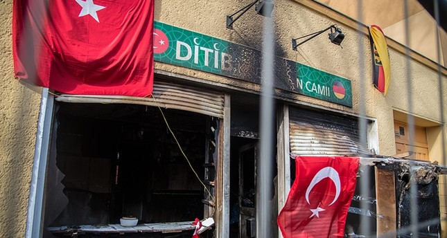 Turkish and German flags are seen on March 16 in front of the Koca Sinan Mosque that was set ablaze on March 11 by PKK supporters. (Sabah File Photo)