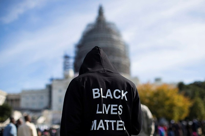 A man wearing a hoodie that reads ,Black Lives Matter, stands on the lawn of the Capitol Building in Washington, D.C. (Sabah File Photo)