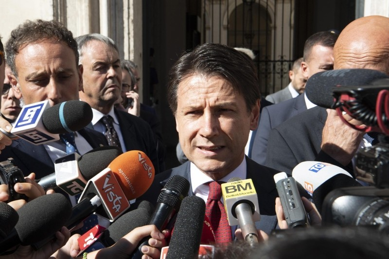 Italian PM Giuseppe Conte speaks to journalists outside of Chigi Palace in Rome, Italy, Sept. 28, 2018. (EPA Photo)