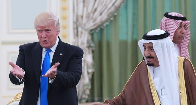 U.S. President Donald Trump and Saudi Arabia's King Salman bin Abdulaziz al-Saud take part in a signing ceremony at the Saudi Royal Court, Riyadh, May 20, 2017.