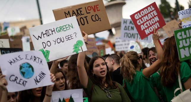 Greek students and activists of environmental organisations hold placards and shout slogans during a Global Climate Strike rally of the movement Fridays for Future in Athens, Greece, September 20, 2019. (Reuters Photo)
