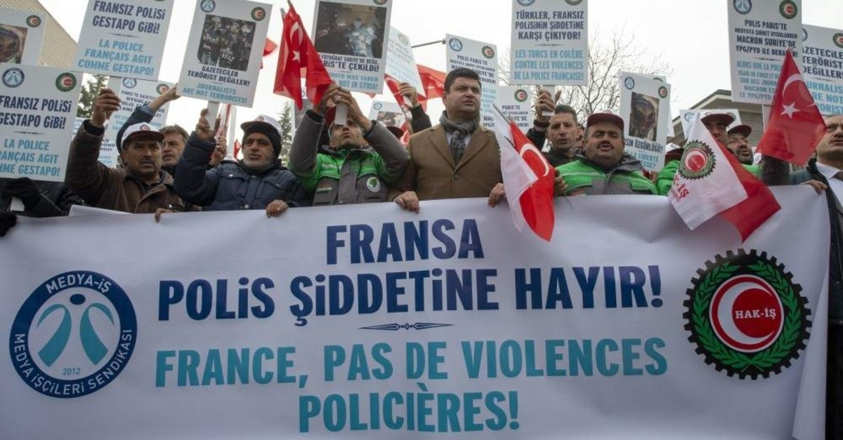 Protesters hold a banner reading ,No To French police violence, in Turkish and French, Ankara, Dec. 9, 2019. (AA Photo)