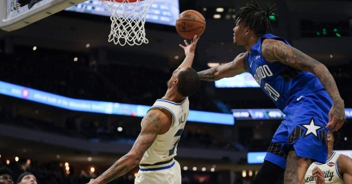 Orlando Magic's Markelle Fultz fouls Milwaukee Bucks' George Hill as he shoots during the second half of the game, Milwaukee, Dec. 9, 2019. (AP Photo)
