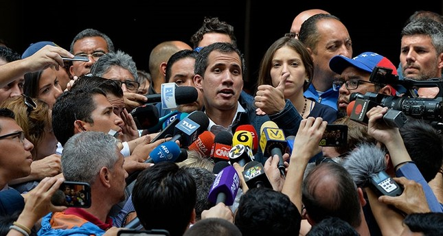 Venezuela's National Assembly head Juan Guaido speaks to the press after attending a mass at the San Jose church in Caracas on Jan. 27, 2019. (AFP Photo)