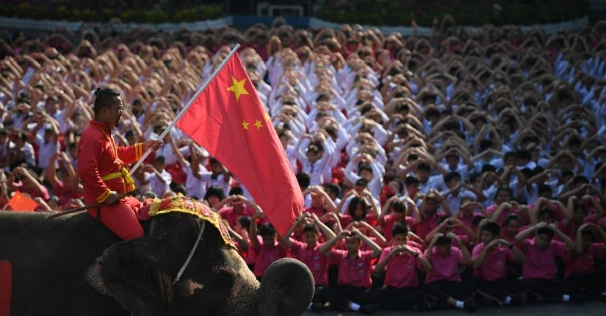 An elephant joins Thai students as they form a heart shape on Valentine's Day to show their support for China in the fight against coronavirus in Ayutthaya, outside Bangkok, Thailand, Feb. 14, 2020. (Reuters)